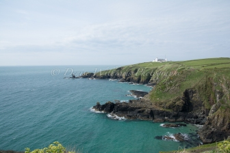 Gorgeous view looking back towards the Lizard Lighthouse on the coastal path to Housel Bay, Cornwall